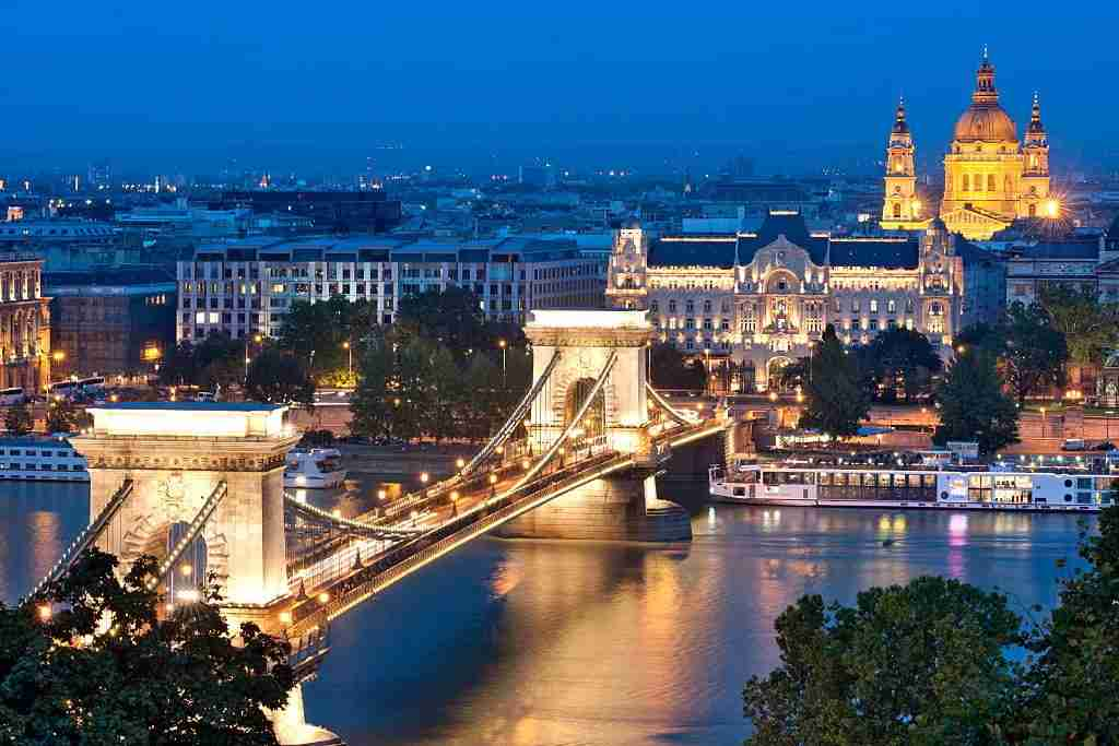 A night view of Szechenyi Chain Bridge over the Danube River in Budapest. Image courtesy of Loop Images via Getty Images.
