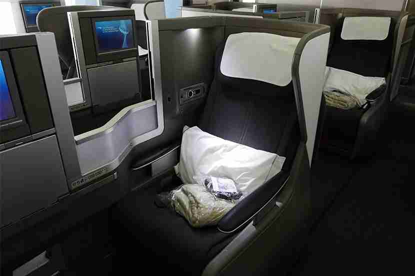 An aisle seat in Club World. Pillow, blanket and headphones included.