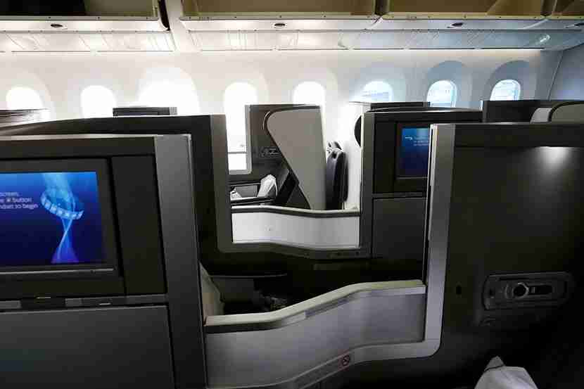 View from aisle seat across the three then two seats in this 2-3-2 arranged Club World cabin.