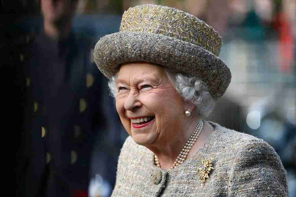 LONDON, UNITED KINGDOM - NOVEMBER 6: Queen Elizabeth II smiles as she arrives before the Opening of the Flanders