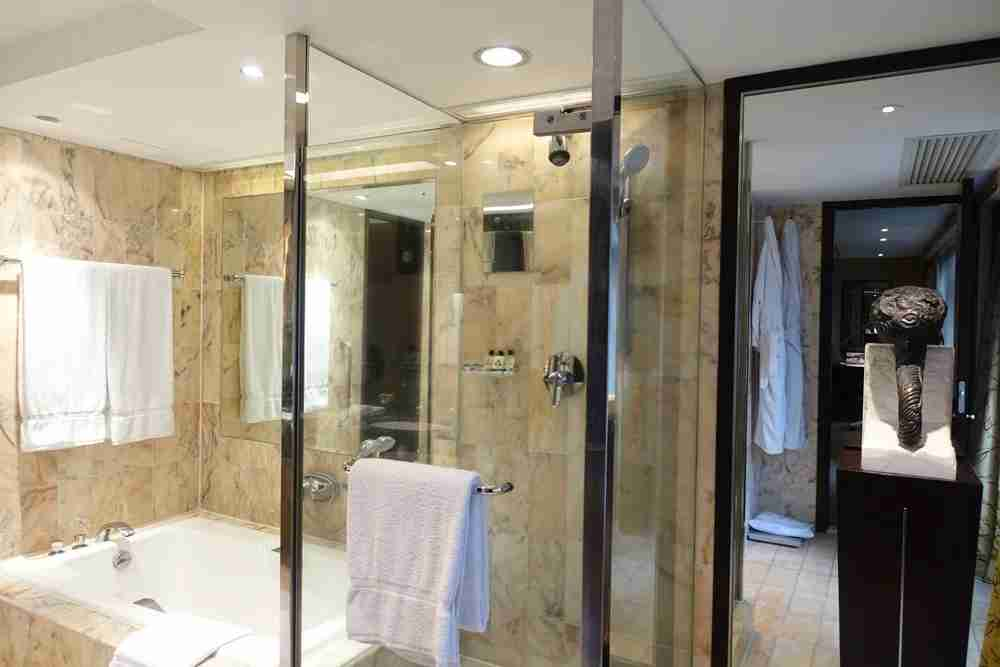 Shower, tub and sculpture