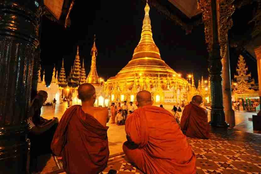 Mynamar, Yangon. Burmese buddhist monk praying near the Shwedagon pagoda. Image courtesy of Pongsan Mabai / EyeEm via Getty Images.