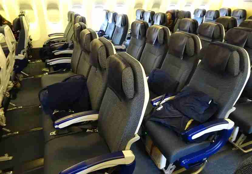 Four seats in the center in Economy.