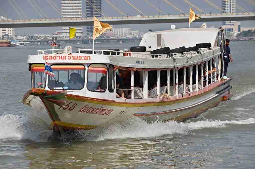 A ferry boat on the Chao Praya river. Photo courtesy of Jonas Gratzer via Getty.