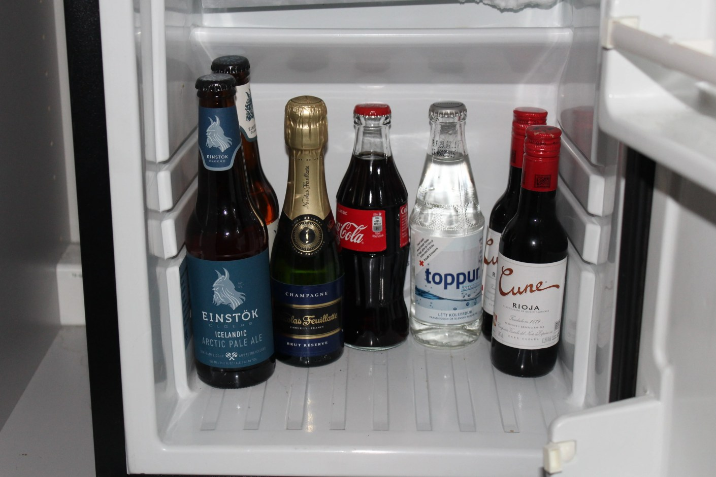 The minibar contained no snacks, just a small assortment of beverages without a price sheet.