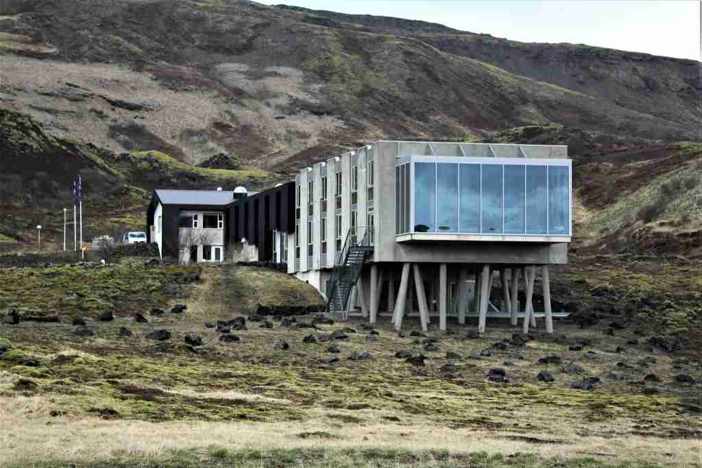 The property has been built directly into the side of the hill with concrete pylons supporting the building.