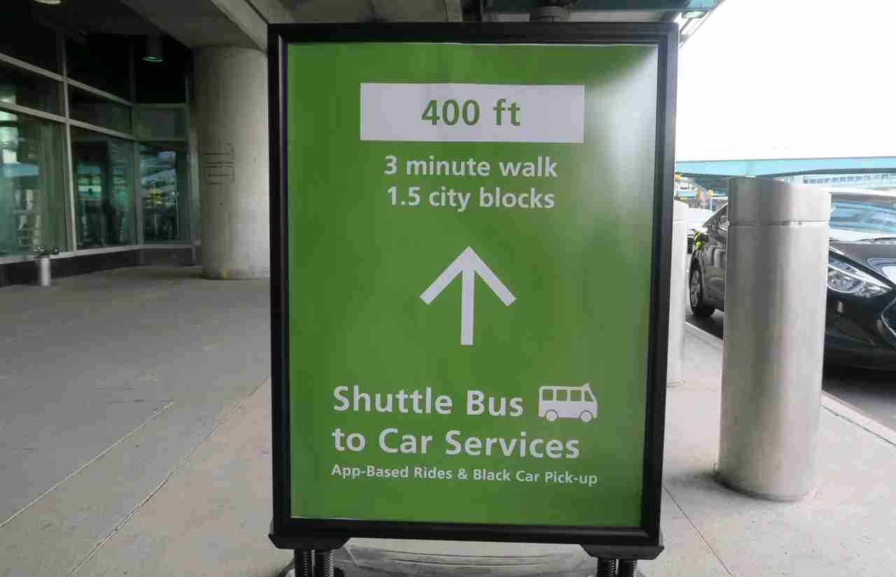 LGA sign to shuttle buses
