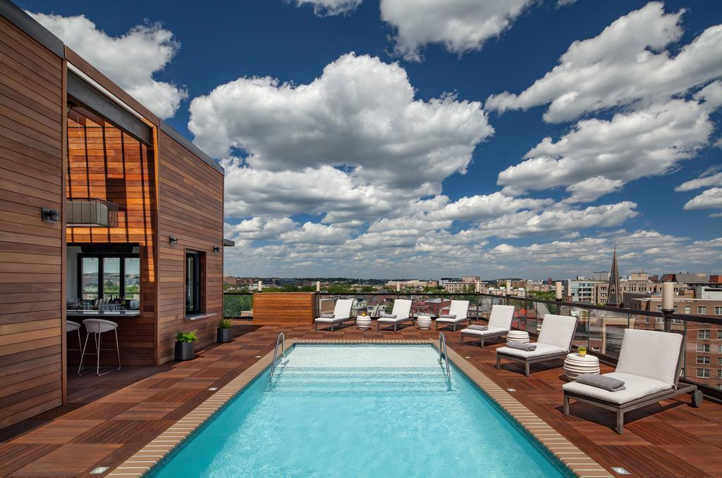 Catch a swim before the fireworks on the rooftop of Mason & Rook hotel. Image courtesy Kimpton.