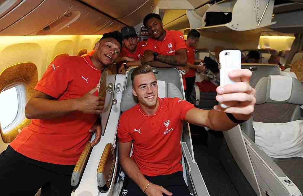 Taking selfies for personal memories seems to be okay on airplanes. Image of Aresenal courtesy of Stuart MacFarlane via Getty Images.