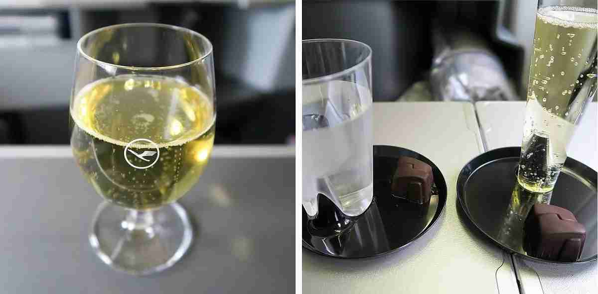 Both airlines served sparkling wine at boarding — Lufthansa (left) in glassware and United (right) in plastic.