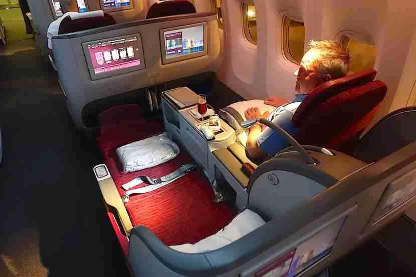 Qatar 777 reclined overhead