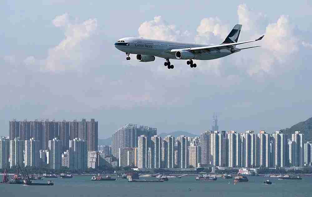 A Cathay Pacific plane flies over the city. Image by Dale de la Rey/Getty Images.