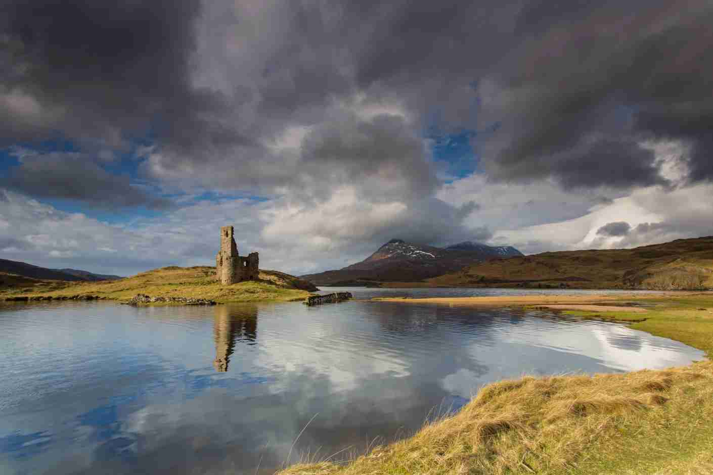 Spark your imagination at the quiet ruins of Ardvreck Castle along Scotland