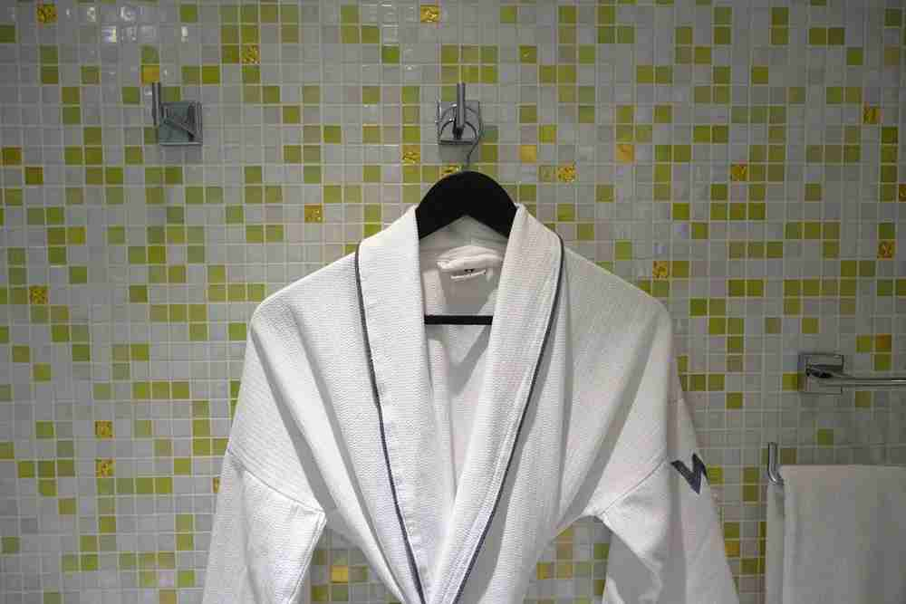 The other robe hung in the bathroom.