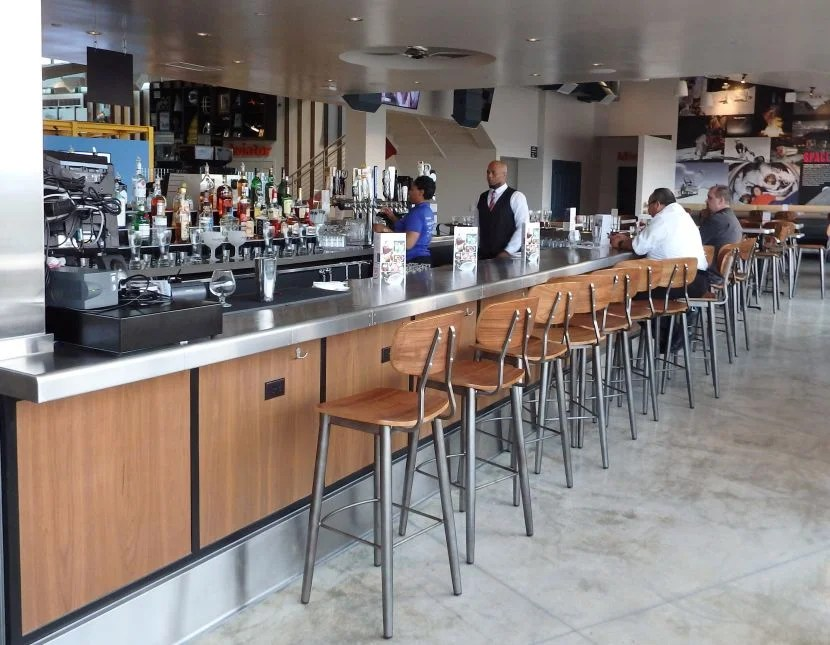 The ample bar at The Proud Bird serves all types of drinks.