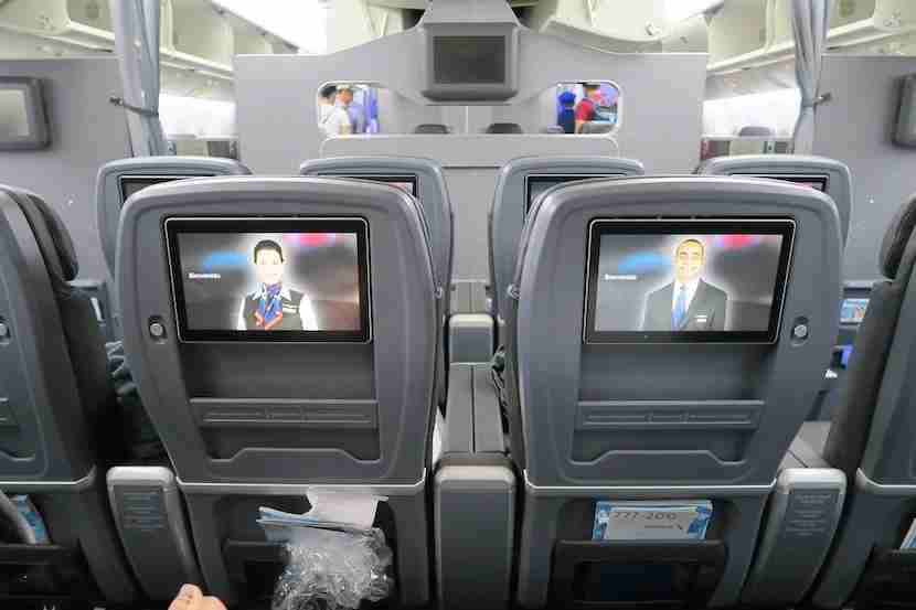 AA-772-premium-economy-IFE-and-view-forward-toward-biz-class