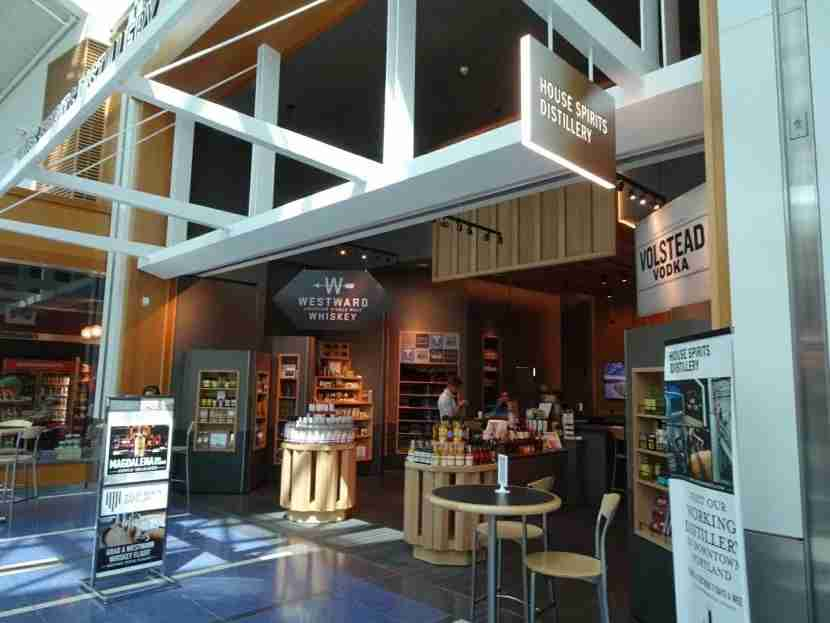 The House Spirits Distillery at PDX has great items for sale, but not all are free with Priority Pass.
