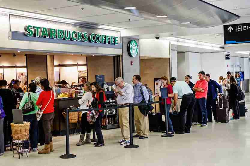 Delta and Alaska passengers do not have to queue at the airport for their coffee fix as these airlines are now serving Starbucks Coffee in the air. Photo by Jeffrey Greenberg/UIG via Getty Images