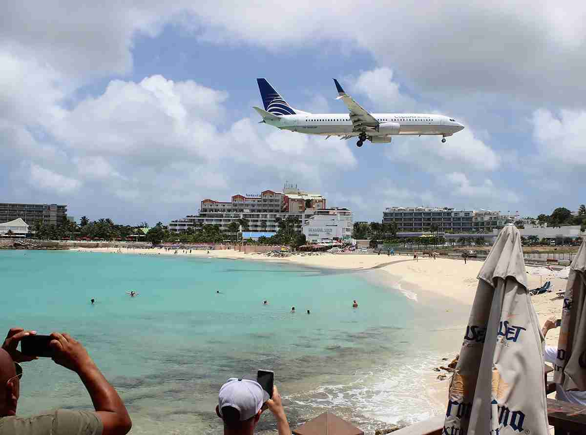 A common-as-rain 737 would elicit plane-spotter yawns anywhere else. But at Maho Beach, it