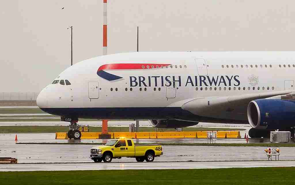 VANCOUVER, CANADA - OCTOBER 25: A British Airways Airbus A380 sits on the outer tarmac at Vancouver International Airport in Richmond, Vancouver on October 25, 2016. At least 25 people were taken to hospitals after a British Airways plane carrying 400 passengers made an emergency landing at the Vancouver International Airport, Canadian media reported Tuesday. The Airbus A380 airplane, traveling from San Francisco to London, was diverted to Vancouver and was surrounded by emergency vehicles when it landed just before midnight Monday. (Photo by Richard Lam/Anadolu Agency/Getty Images)