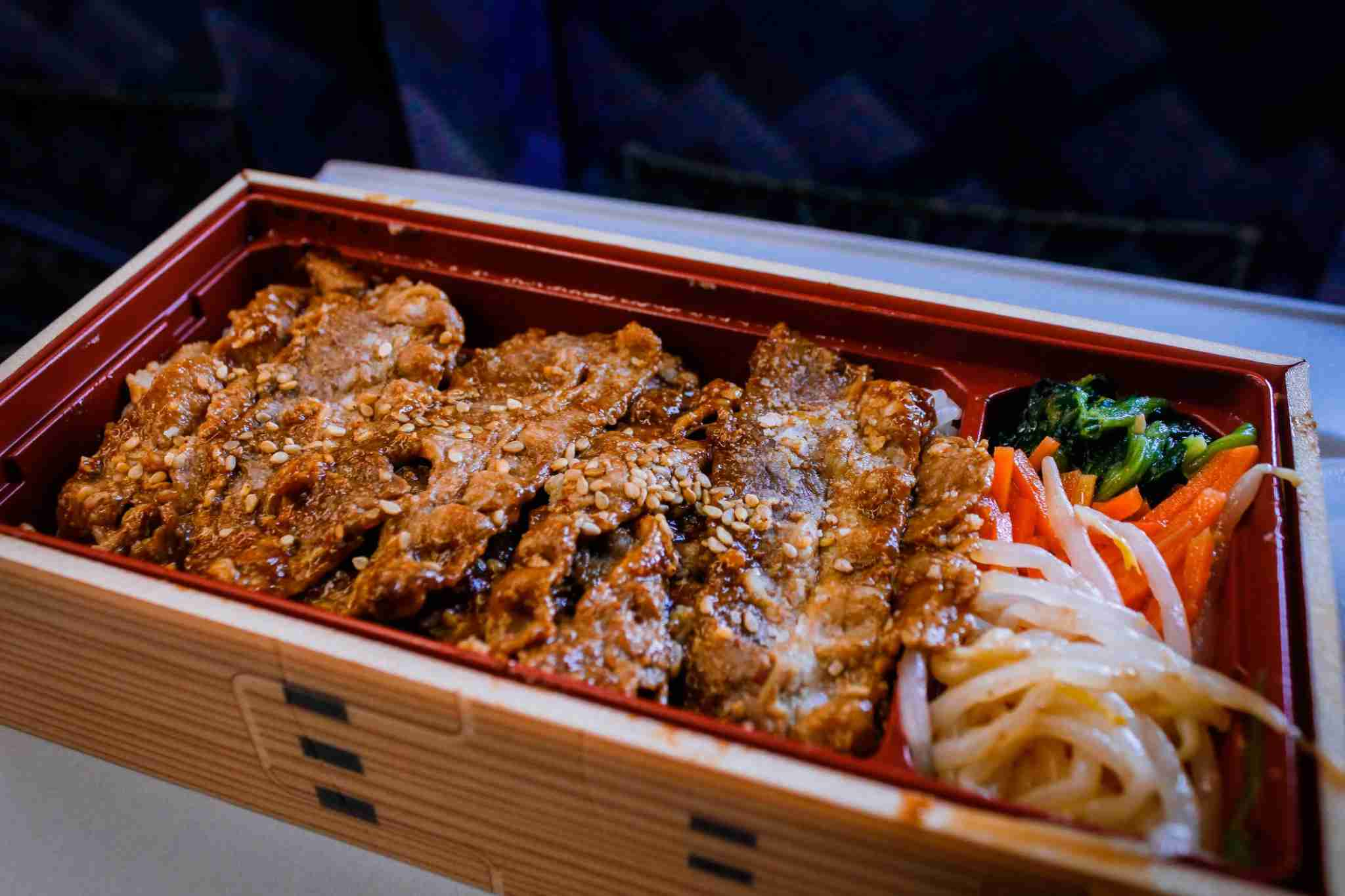 You can buy bento boxes, sushi, and beer on board or at any train station. Image by Suphat Bhandharangsri Photography/Getty Images.