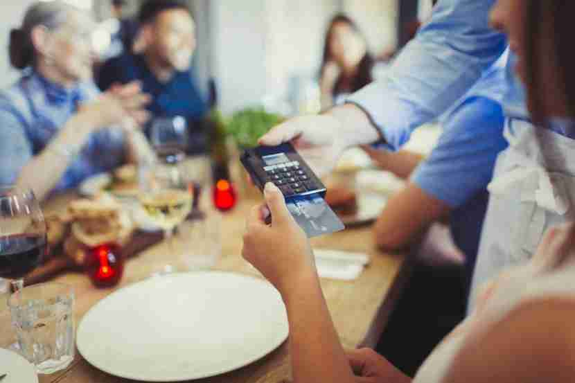 The average American household spends more than $3,000 per year at restaurants. Image courtesy of Caiaimage/Paul Bradbury via Getty Images.