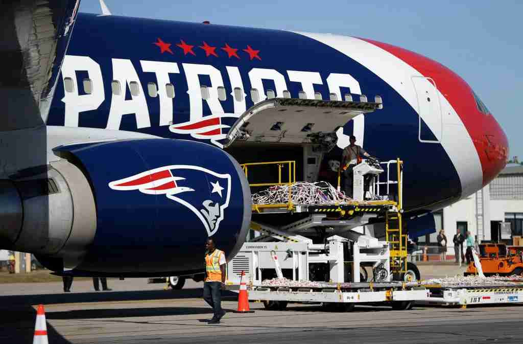 WARWICK, RI - OCTOBER 4: Ground crew members prepare the New England Patriots