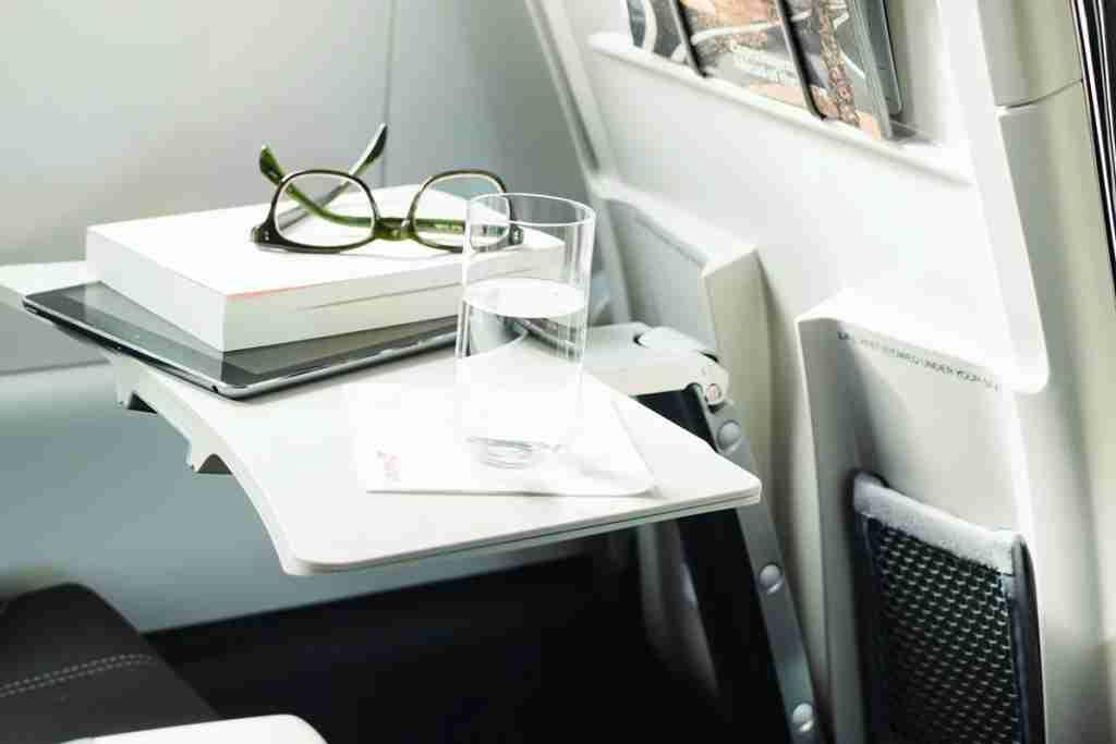 Ergonomically designed tray tables and carveouts for maximum knee space.