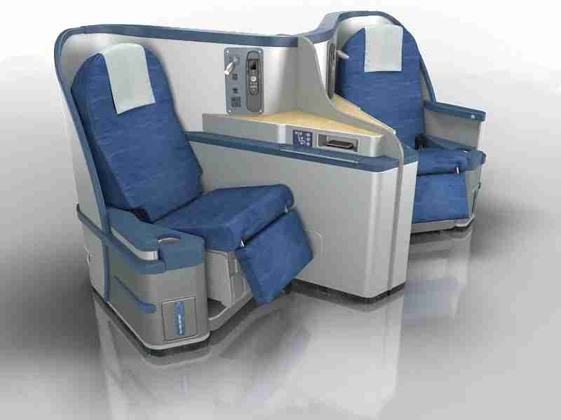 The Envoy suite is a very good onboard product, but the seats could use new seat covers. Image courtesy of American Airlines.