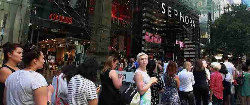 SYDNEY, AUSTRALIA - DECEMBER 07: Large crowds line-up for the opening of trade at Sephora at Pitt Street Mall during the Christmas shopping period on December 7, 2014 in Sydney, Australia. (Photo by Lisa Maree Williams/Getty Images)