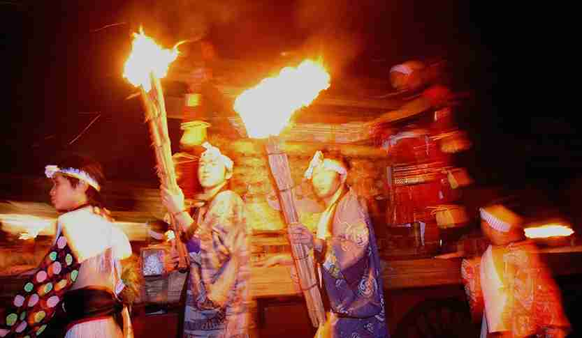 Burning torches are carried along with a portable shrine during the Kurama Fire Festival. Photo by Koichi Kamoshida/Getty Images