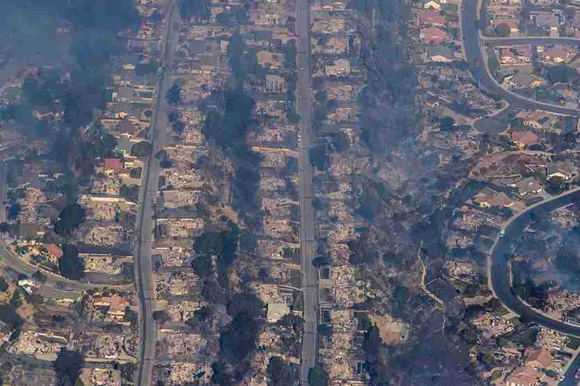 Dozens of homes are destroyed in a neighborhood in view of the Thomas fire from helicopter. (Photo by Brian van der Brug/Los Angeles Times via Getty Images)