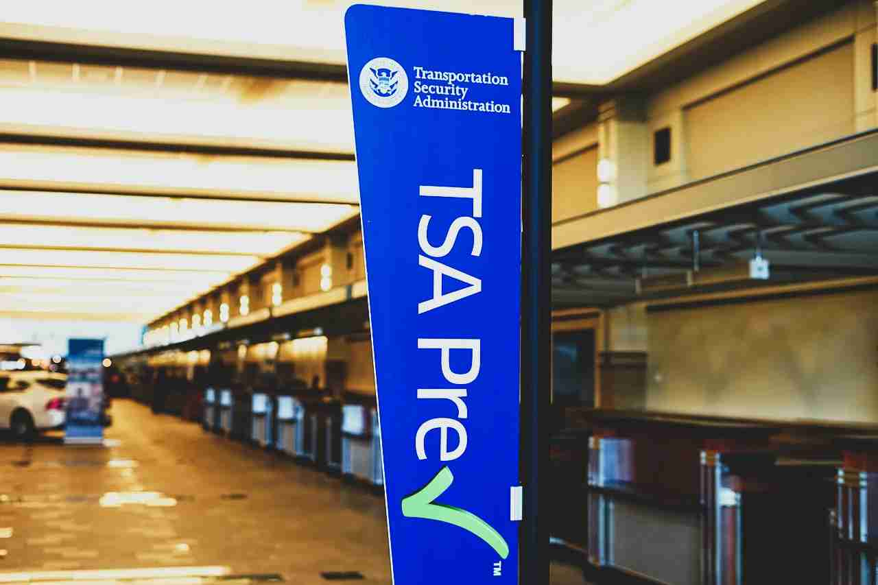 Sign encouraging passengers to register for the time-saving TSA Prec Check program in the United Airlines (UA) terminal at the Chicago O