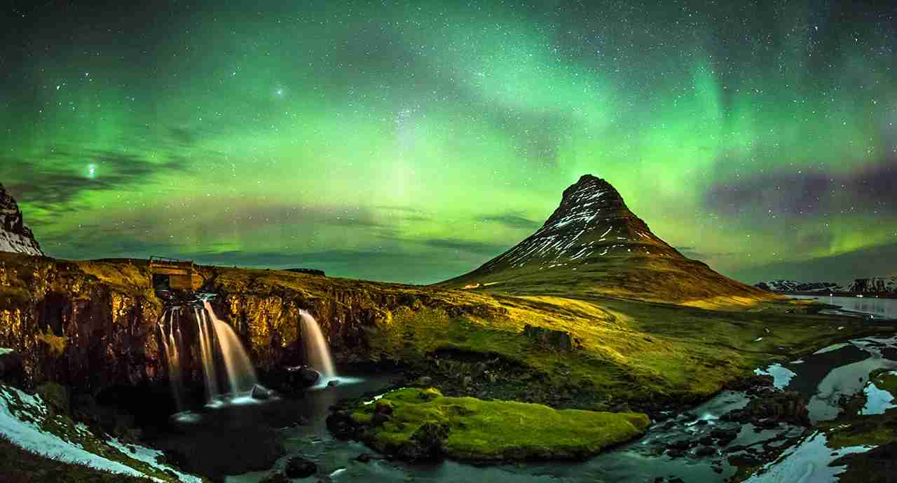Aurora borealis at Mount Kirkjufell Iceland. (Photo by SuppalakKlabdee / Getty Images)