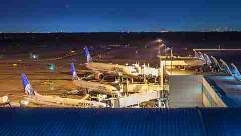 Aircrafts from United Airlines docked at terminal E at George Bush Intercontinental Airport at night