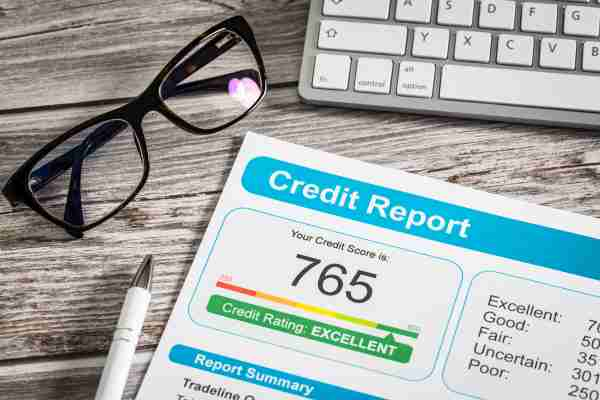 Even if your credit score is high, errors on your report may still be impacting it. Image courtesy of scyther5 via Getty Images.