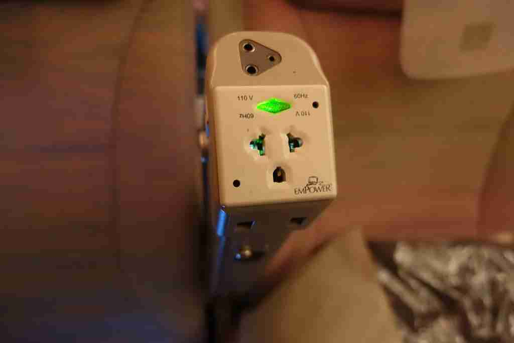 Power outlet in economy class on the Emirates A380 between New York (JFK) and Milan, Italy (MXP).