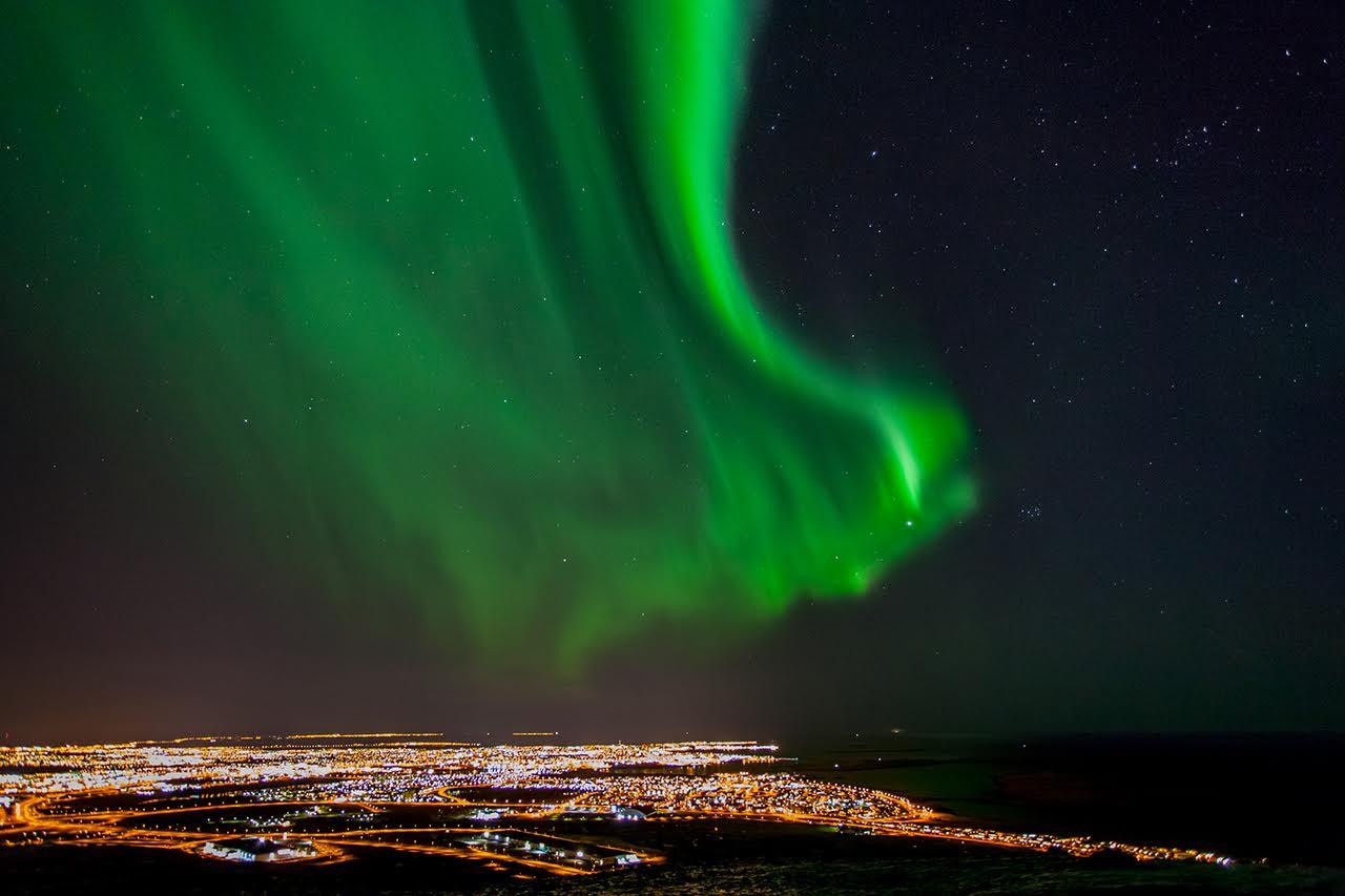 Aurora Borealis, Northern lights over Reykjavik Iceland.Credit: Friðþjófur M. / Getty Images
