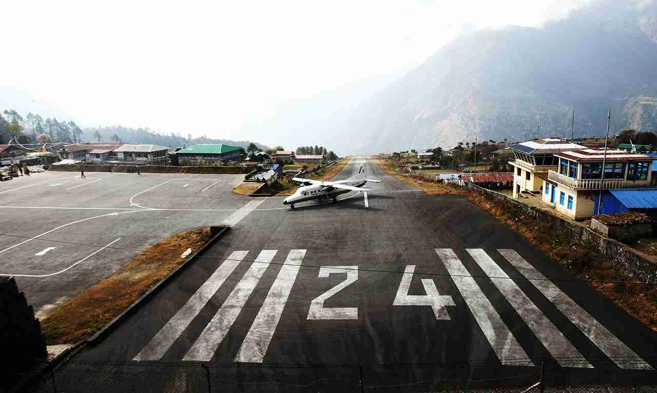 A Tara Air Dornier Do 228 aircraft taxis after landing at the Tenzing-Hillary Airport in Lukla, 87 miles northeast of Kathmandu. (Photo by PRAKASH MATHEMA/AFP/Getty Images)