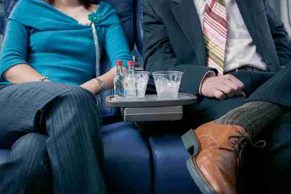 Sharing a drink with the person sitting next to you. (Photo by ColorBlind Images/Getty Images)