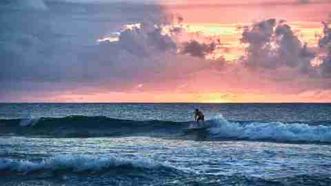 Surfer at sunset in Rincon