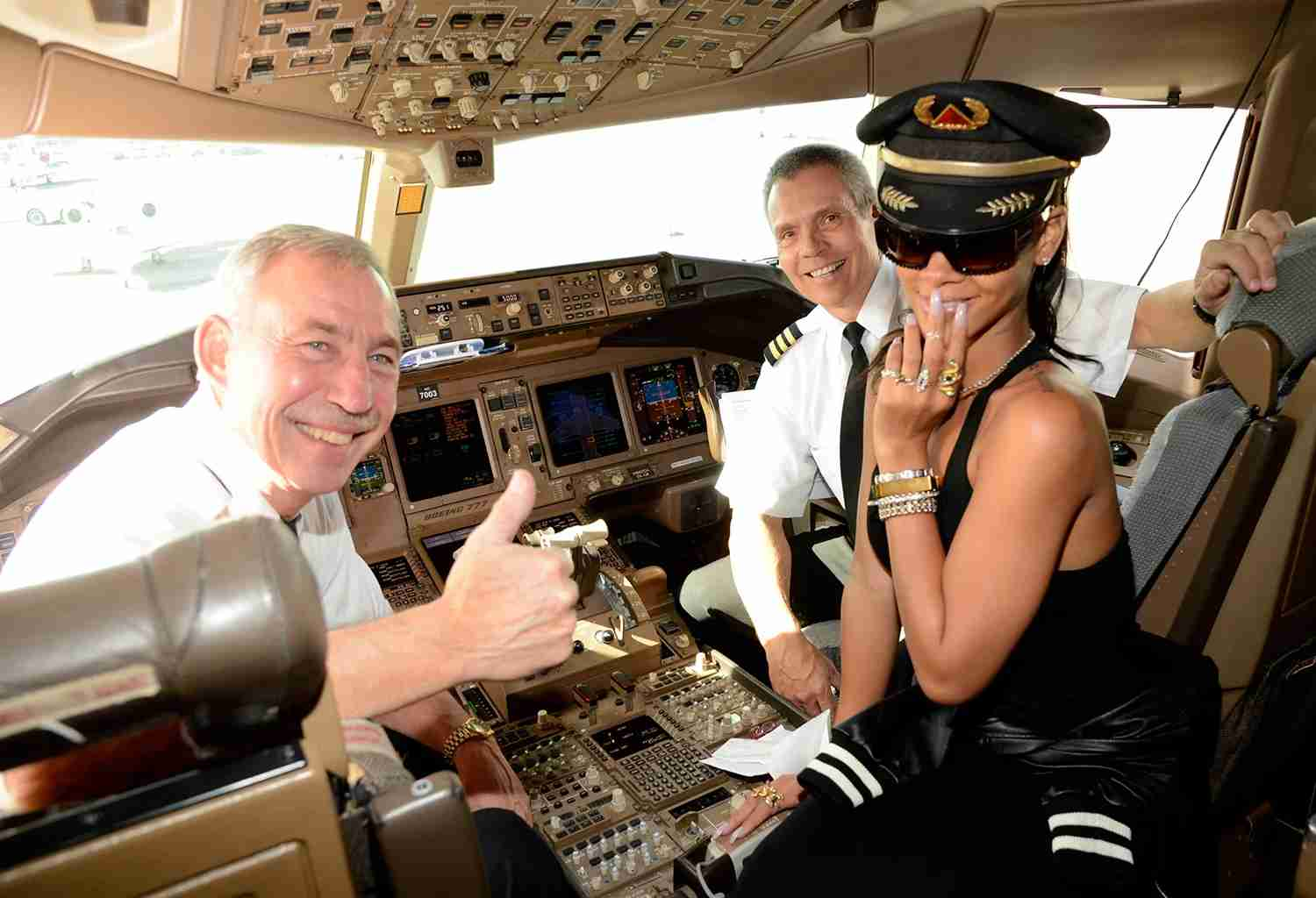 Rihanna sits in the cockpit of a Delta Boeing 777, November 14, 2012. (Photo by Kevin Mazur/WireImage)