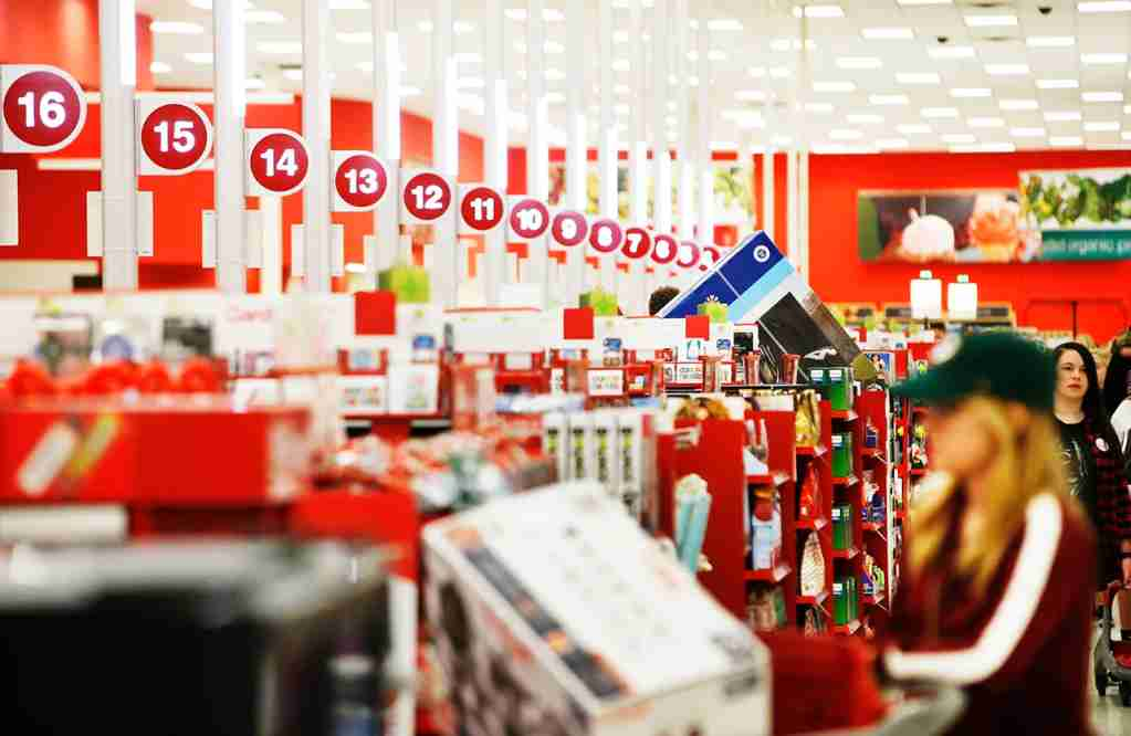 "Shoppers check out with ""Black Friday"" deals at a Target on November 24, 2016 in Orem, Utah. Retailers kicked off the unofficial start of the holiday season with sales that in many instances began on the Thanksgiving holiday. (Photo by George Frey/Getty Images)"