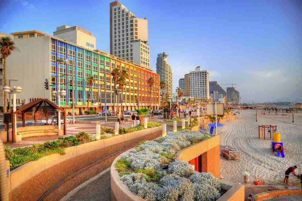 Check out the colorful hotels along the beach in Tel Aviv. (Photo by Danor_a/Getty Images)