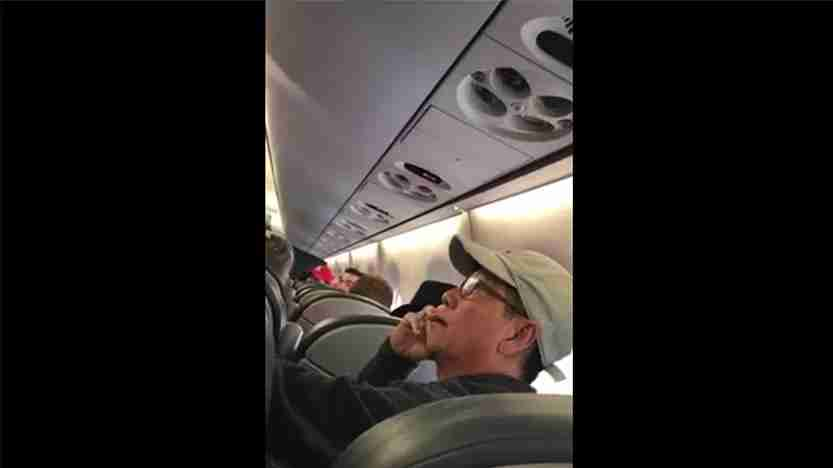 A Facebook video captured David Dao before he was dragged off the plane. (Photo by Joya Cummings / Facebook)