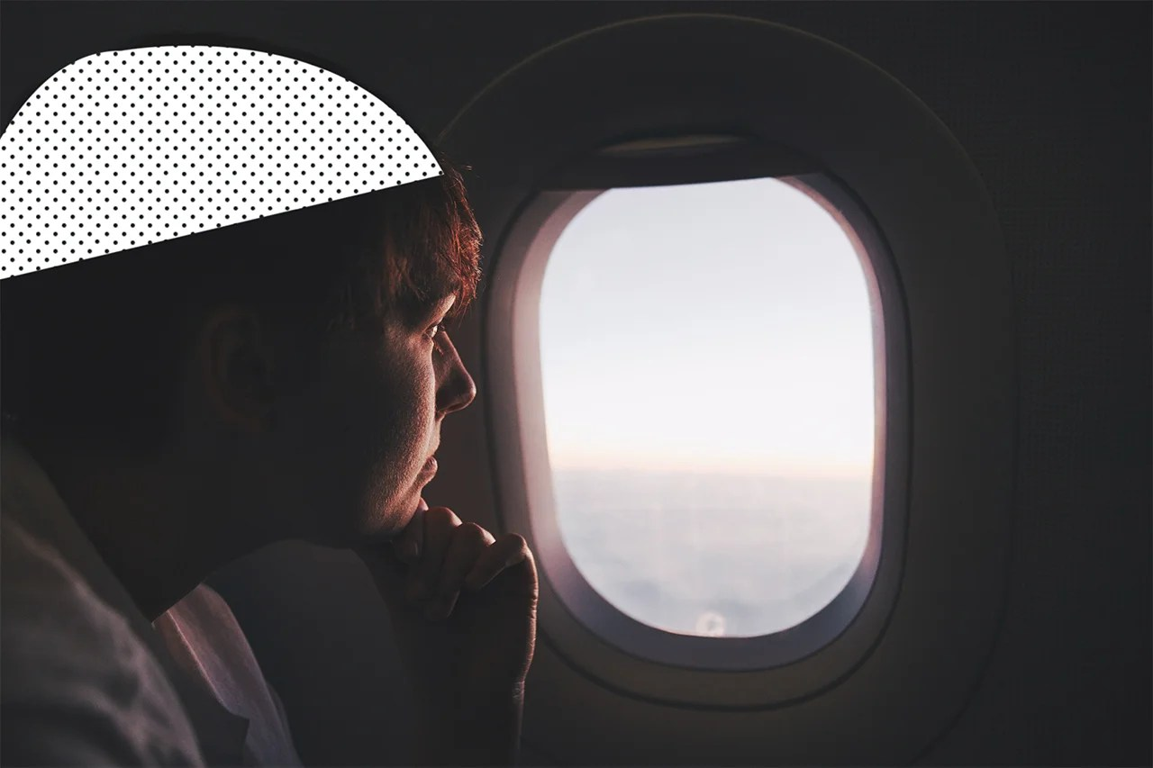 How to Trick Your Mind Into Enjoying Long Flights, According to a Travel Psychologist
