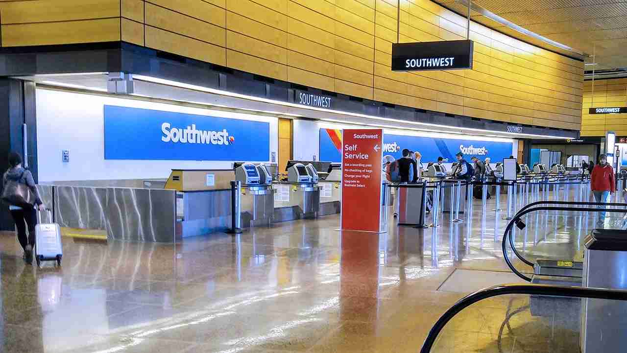Southwest Airlines ticket counter with Priority check-in sign at Seattle-Tacoma International Airport (SEA). (Photo by Evan Didier via Flickr)