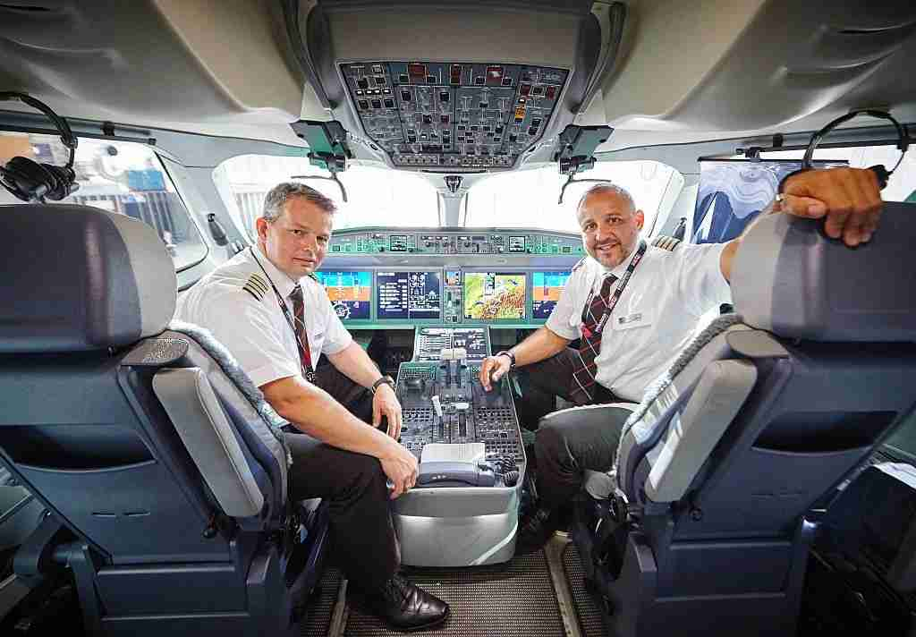Pilots pose inside the cockpit of Swiss International Air Lines