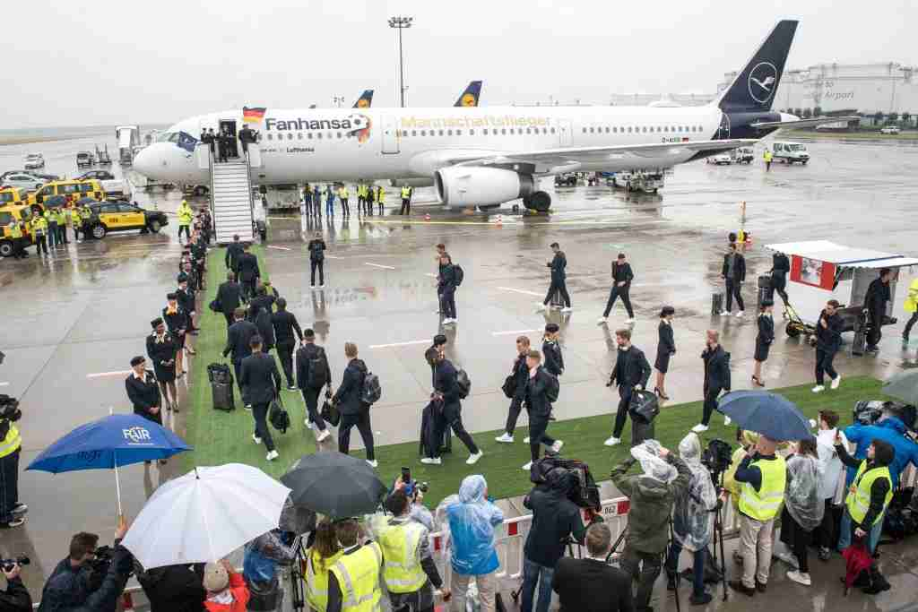 FRANKFURT AM MAIN, GERMANY - JUNE 12: The German national team walk to the Lufthansa plane at Frankfurt International Airport to depart to the 2018 FIFA World Cup Russia on June 12, 2018 in Frankfurt am Main, Germany. (Photo by Thomas Lohnes/Bongarts/Getty Images)