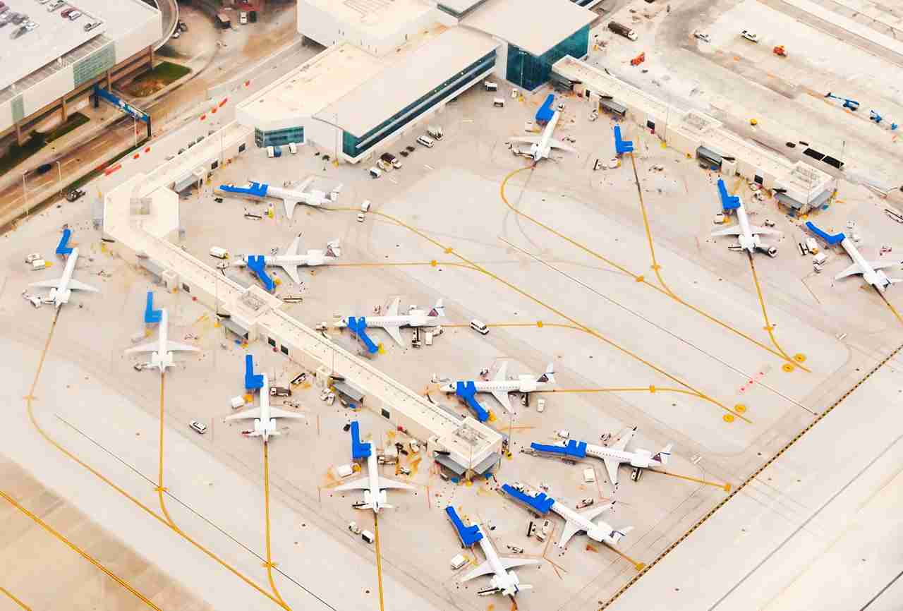 Ariel view of Airport scene with planes lined up at terminals , remote parking, taxiways, runways and airplanes ready to depart. (Photo by vu3kkm/Getty Images)